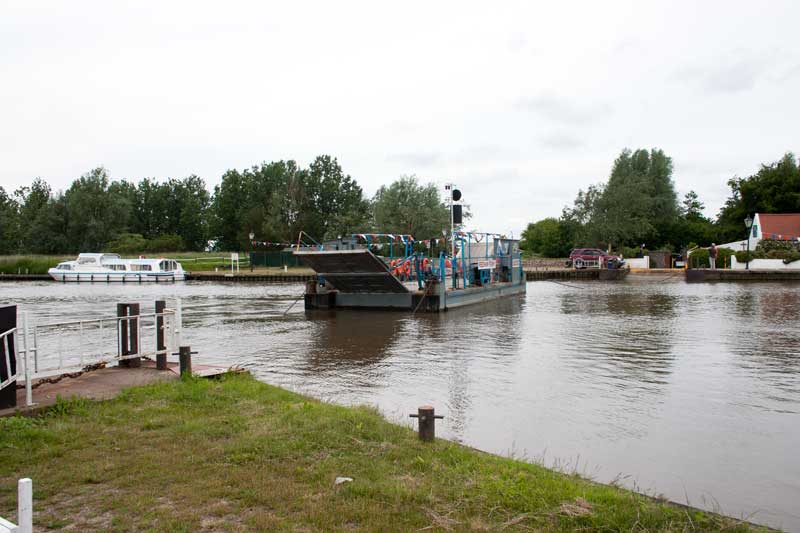 The Reedham Ferry crosses the River Yare